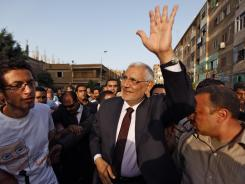 Egyptian presidential candidate Abdel-Moneim Abolfotoh is welcomed by his supporters in Monofeya, Egypt, on Thursday.