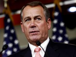 House Speaker John Boehner speaks during his weekly news conference on Capitol Hill in Washington on Thursday.