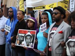 People walk in a silent protest march to demand justice for the shooting of Trayvon Martin on April 9 in Los Angeles, Calif.