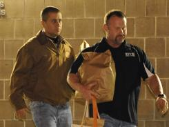George Zimmerman, left, walks out of the intake building at the John E. Polk Correctional Facility with a bondsman on Sunday in Sanford, Fla.