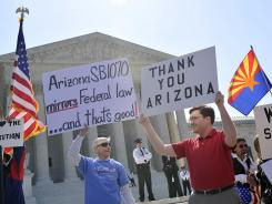 SB1070 supporters: Demonstrators rally outside the U.S. Supreme Court on Wednesday.