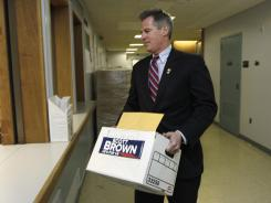 Sen. Scott Brown, R-Mass., drops off signature petitions April 10 in Boston to qualify for being placed on the ballot.