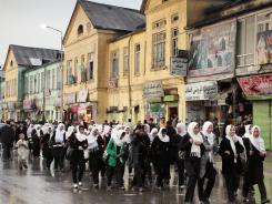 Afghan schoolgirls walk home after class in downtown Kabul, Afghanistan, earlier this month.