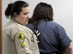 Jessica Lynn Lopez, right, is led out of court April 19 in Vista, Calif.