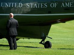 A Secret Service agent stands by the Marine One helicopter Friday in Washington.