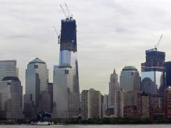 In this view from a ferry boat near Jersey City, ongoing construction is seen at One World Trade Center.