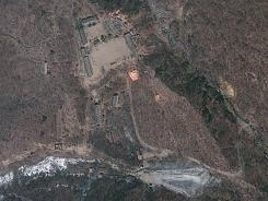 This April 18, 2012, satellite image provided by GeoEye appears to show a train of mining carts, at the lower center of the frame, and other preparations underway at North Korea's Punggye-ri nuclear test site.