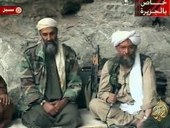 Osama bin Laden, left, and Ayman al-Zawahri are seen at an undisclosed location during a television broadcast on Oct. 7, 2001.