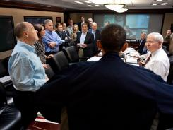 This May 1, 2011, official White House photo shows President Obama with members of the national security team after a meeting discussing the mission against Osama bin Laden.