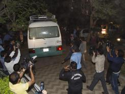 Media chase a minivan carrying the family of Osama bin Laden in Islamabad on Thursday.