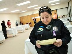 "Hermiston Police crime prevention officer Erica Franz takes part in the ""In Her Shoes"" domestic violence workshop at Good Shepherd Medical Center in Hermiston, Ore., on April 17."