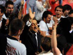 French President Nicolas Sarkozy waves as he arrives to deliver a speech during a campaign meeting on Sunday in the southwestern city of Toulouse.