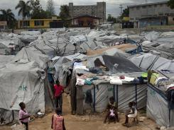Residents of a camp for those displaced by the 2010 earthquake are photographed Thursday in Port-au-Prince, Haiti.
