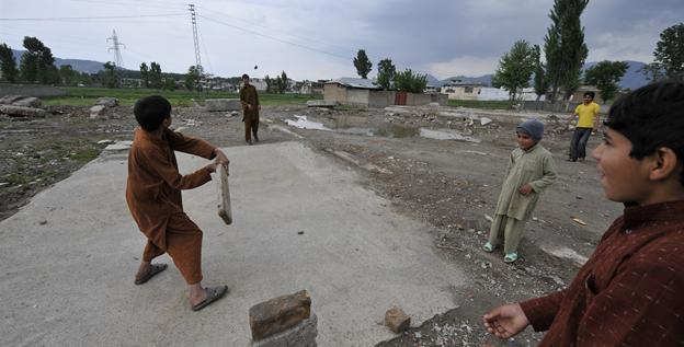Pakistani youths play cricket at the site of the demolished compound of slain Al-Qaeda leader Osama bin Laden in Abbottabad on Wednesday.