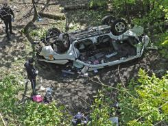 Authorities say an out-of-control van plunged off a roadway near the Bronx Zoo, killing seven people, including three children.