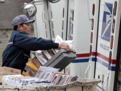 Diosdado Gabnat moves boxes of mail into his truck in Seattle in December.