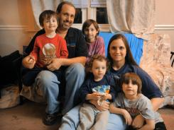 Life at home in Glen Mills, Pa., is often chaotic for the May family, including John Jr., 3, left, John, James, 10, Nicholas, 2, Nicole and Dominic, 6.