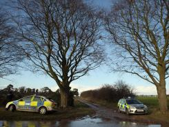 Police guard the entrance to woods near Queen Elizabeth II's rural Sandringham Estate on Jan. 3.