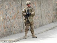 A U.S. soldier stands guard during a ceremony on the outskirts of Kabul on March 15.