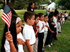 In Tyler, Texas: Students recite the Pledge of Allegiance.