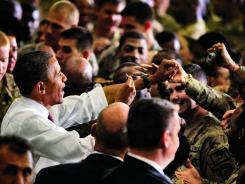 Surprise visit: President Obama addresses troops at Bagram Air Field, Afghanistan.