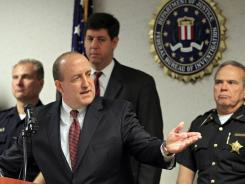 FBI Special Agent in Charge Stephen Anthony points to a map of an attempted bridge bombing at the bureau's office in Cleveland on Tuesday.