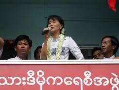 Burma pro-democracy icon Aung San Suu Kyi delivers a speech during an inauguration ceremony Tuesday in Rangoon.