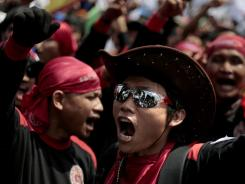 Workers shout slogans during Tuesday's rally to mark May Day in Jakarta, Indonesia.