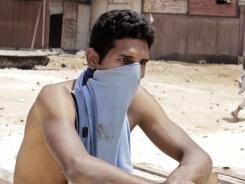 A protester waits during Wednesday's clashes in Cairo.