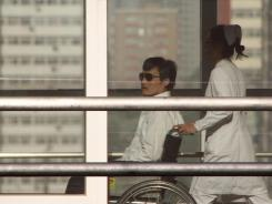 In the wheelchair: Chen Guangcheng on Wednesday at a hospital in Beijing.
