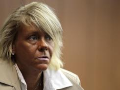Patricia Krentcil, 44, pleaded not guilty to charges of endangering her 5-year-old daughter by taking her into a tanning salon.