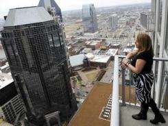 "Laurie Sheinkopf, 50, a real estate broker, moved into a 1,600-square-foot condo in downtown Nashville after selling her 3,500-square-foot suburban home after a divorce. ""When you're single, you have half as much time to do twice as much,"" she said."