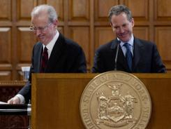 New York Attorney General Eric Schneiderman, right, takes the podium after being introduced by Chief Judge Jonathan Lippman during a Law Day ceremony at the Court of Appeals in Albany, N.Y., on Tuesday.