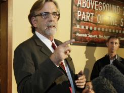 Attorney John Henry Browne talks to reporters March 30 in Seattle.