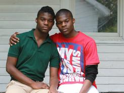 """Darnell """"Dynasty"""" Young, left, a gay high school student in Indianapolis, is on suspension and faces possible expulsion after using a Taser to scare off a group of six kids who used gay slurs and threatened to attack him on campus. Dynasty is photographed with his twin brother, Darell."""