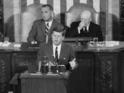 May 25, 1961: President Kennedy speaks before a joint session of Congress in Washington. In the background are Vice President Johnson, left, and House Speaker Sam Rayburn.