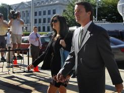 John Edwards and his daughter Cate Edwards enter the Federal Courthouse in Greensboro, N.C., on Thursday.