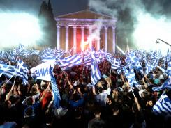 Supporters of Leader of the Greek conservative party New Democracy Antonis Samaras wave flags during a pre-election speech in Athens on May 3.