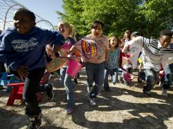 A group of children race to be first onto the Woodland Discovery Playground during an Easter egg hunt in Memphis. Two new studies now suggest parents today may be happier than non-parents.