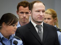 Anders Behring Breivik, center, stands in an Oslo courthouse on Thursday, the 11th day of his terror trial.