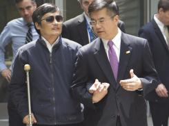 Legal activist Chen Guangcheng, left, speaks with U.S. ambassador to China Gary Locke as they leave the U.S. embassy for a hospital in Beijing earlier this week.
