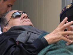 Former Egyptian President Hosni Mubarak lies on a stretcher in January as he leaves court in Cairo.