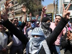 Anti-Syrian regime protesters chant slogans against President Bashar Assad during a demonstration after Friday prayers in Beirut.