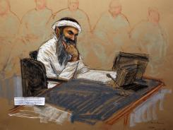 In this courtroom drawing reviewed and approved for release by a U.S. military security official, Khalid Sheikh Mohammed sits in court on Saturday at the U.S. Naval Base in Guantanamo Bay.