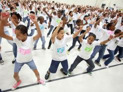 "Fifth-graders celebrate the anniversary of the ""Let's Move! Flash Workout,"" in support of first lady Michelle Obama's ""Let's Move!"" initiative to fight childhood obesity on Thursday in Durham, N.C."