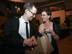 Former Iranian hostages Shane Bauer and Sarah Shourd grab gift bags after attending Muhammad Ali's birthday party at the Muhammad Ali Center on Jan. 14.