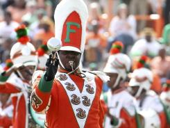 In this Oct. 8, 2011 file photo, Florida A&amp;M Marching 100 Drum Major Robert Champion performs in Tallahassee.