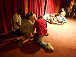 The new wave: Students pray together at a conference in New Mexico.