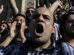 Egyptian protesters chant slogans demanding that the ruling military council release colleagues detained by the army during a protest Sunday in front of the Defense Ministry in Cairo.