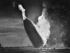 The Hindenburg crashes to the ground after exploding on May 6, 1937, at the U.S. Naval Station in Lakehurst, N.J.